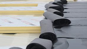 PIR isolatie en bitumen: partners op het dak